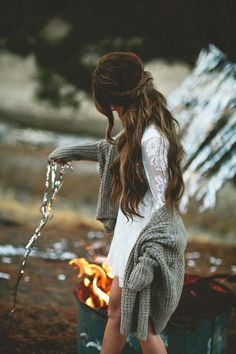 Messy hair, white lace and an oversized knit mean you can still look cute next to a campfire