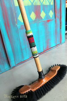 This makes sweeping the floor a bit more fun. Yarn bomb your broom.