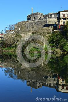 Historical sight of Barcelos city, Portugal, with the Palace ruins reflected on the river.