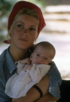funnybunnysgirl:  Catherine Deneuve with her son Christian July 1963