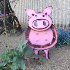 This piglet is as cute as it gets! Solar powered marquee statuary lights up automatically at night.