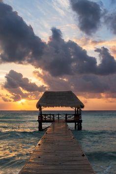 Sun at Playa del Carmen, Mexico, by Yuri Kriventsoff, on 500px. (Trimming)