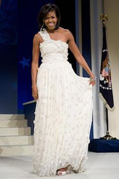 WOW!!! Michelle Obama stunned at the inaugural balls four years ago when she wore a one shouldered, floor length Jason Wu gown. The decision then by the First Lady to wear the 26 year old's dress took the little known designer to celebrity instantly. Four years ago when Obama came out in his gown, Wu had only three employees and was at home eating pizza with a friend.