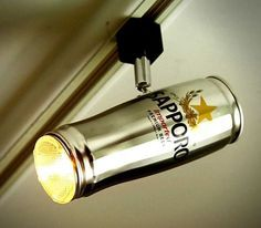 The Beer Can Track Lighting is an ingenious fixture that transforms a common beer can from something dull and useless into a very practical and very original item.