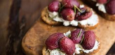 Giving grapes some time in the oven serves to elevate their natural sweetness and makes them a perfect foil for the creamy goat cheese in this delightful appetizer.
