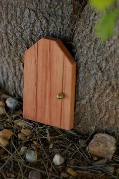 HOW CUTE!!!! It's a little gnome or fairy door!!!