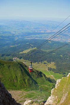 A cable car ascends Switzerland's Mount Pilatus.
