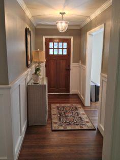 Added wainscoting to entryway.  Love the door, too.
