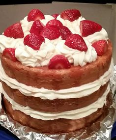 Strawberry cake with cream cheese frosting and fresh strawberries & glaze