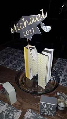 Graduation centerpiece, simply print and add to an initial book. All guests can sign the book!