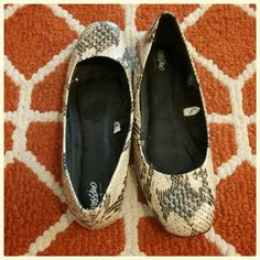 Snakeskin patterned ballet flats Snakeskin patterned ballet flats with silver metal studs. Worn twice. No flaws. Shoes Flats & Loafers