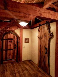 Oak rolling barn door in tiny house.