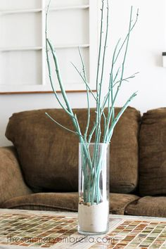 This tree branch centerpiece idea is sure to be a new favorite in your home!