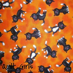 Black Cats Tossed on Orange Fabric from QuiltGirls!