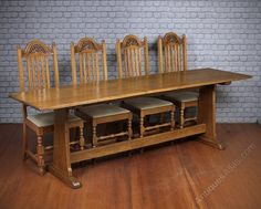 Eight feet long pale oak Arts & Crafts school refectory table c.1910. In solid oak throughout with an inch thick, three plank top on shaped ends and sleigh feet joined with a stretcher. Big enough to seat four down each side. With some damage to the edge of one long side (some unruly school boy