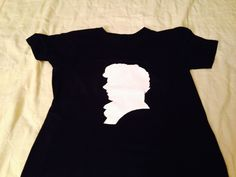 The front: The back: (materials: white fabric paint and a black shirt) Took me forever, but I'm proud!