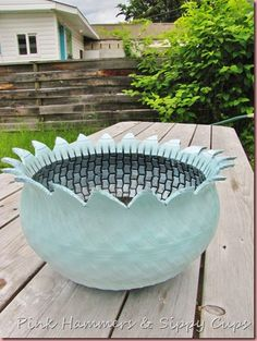 An old tire is cut, turned inside out, and painted to make this awesome planter for flowers