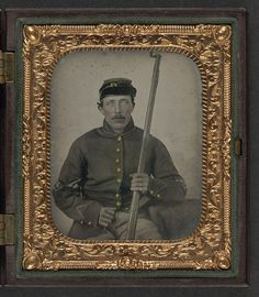 [Unidentified soldier in Union corporal's uniform and forage cap sitting with bayoneted musket] (LOC) by The Library of Congress, via Flickr