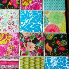 Tiles, mod podge, and scrapbook paper. Use as coasters or a table top.