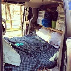 """haRVey the @minivancamper .  --- Toyota Sienna turned camper.  interior bed (6""""mattress, full sized!) that sleeps with head towards front and legs go under shelf.  facing bed on shelf are drawers and buckets with clothes/personal items.  kitchen and food points to the back.  Even has electric when plugged into campsite (used for lights, heater, hot plate, kettle, chargers, etc.)  https://minivancamper.wordpress.com"""