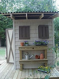 Picture of a shed with plants and pots attached to the outside wall