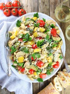 Grilled Chicken and Squash with Tomato Feta Pasta - A complete meal all in one dish, full of savory cheesy tomato flavor and loaded with grilled zucchini, squash and chicken!  #chicken http://tasteandsee.com