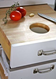 Cutting board drawer over trash drawer...Totally want this!!!!
