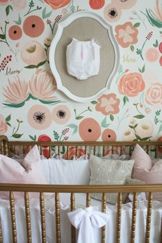 Hand Painted Flower Mural Coral and Pink in Girl's Nursery with Framed Baby Outfit