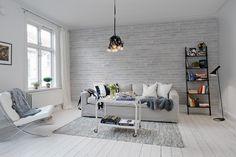 Simple living room interior with the wallpaper Pulp from Rebel Walls. #rebelwalls #wallpaper #wallmurals