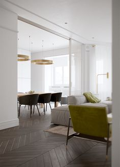 """This refined two-bedroom apartment is the work of design team Vishnyakov & Pokrovsky. Titled """"Honey White"""", its bright interior remains minimalist but sweetly w"""