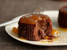 Warm Chocolate Cakes with Apricot-Cognac Sauce | Food & Wine goes way beyond mere eating and drinking. We're on a mission to find the most exciting places, new experiences, emerging trends and sensations.