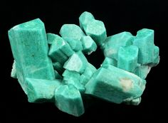 Microcline ( var. Amazonite ) with Albite Confetti Pocket, Smoky Hawk Mine, Buckner Pegmatite, Florissant, Teller Co., Colorado, USA  143 x 107 x 70 mm overall  Largest crystal is 70 mm long. (Author: GneissWare)