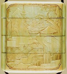 Four case inro. Landscape and buildings. Made of ivory.