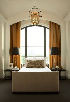 Elegant guest room...Barrel vaulted ceiling, window behind the bed, dramatic window treatments with concealed hardware and overall rich palette