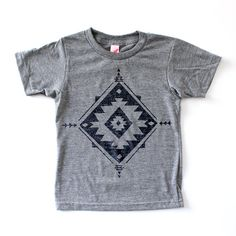 Geo Print on a loose-fitting crew-neck tee. Each design is hand-drawn and screen-printed. Black on Heather Gray.  100% cotton.