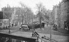 1935 - 1940. A view of the Westerstraat with market in Amsterdam. The Westerstraat is one of the widest streets in the Jordaan section of Amsterdam. Every Monday morning from 9:00 am till 1:00 pm the street houses a large outdoor market. Originally a textiles market, but in the recent years the market went through a transformation. Now merchants are often offering quality clothes and shoes, sometimes bearing the best design labels. #amsterdam #1940 #Westerstraat #Jordaan
