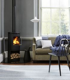 The stoves artistic expression sets it apart from the crowd. Its combination of cast iron and glass are a challenging interpretation of style and function. Building A House, Modern Farmhouse, Wood, Stove, Home, Morso Wood Stove, Hearth, Home Appliances, Wood Burning Stove