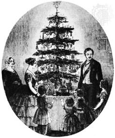 Queen Victoria, Prince Albert, and family around Christmas tree.