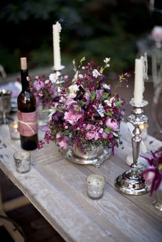 I love the formal silver candle holders and vase on this super casual wood table.  Very vintage and beautiful for on outdoor party or garden party!