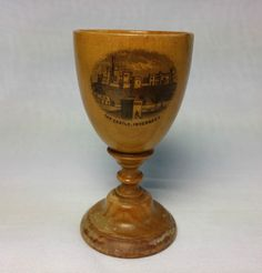 An antique Victorian mauchline ware egg cup, with a great transfer view of The Castle, Inverness.