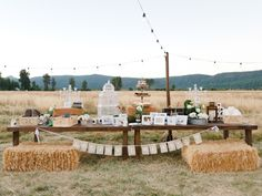outdoor barn wedding, dessert table, hay bales, strung lights