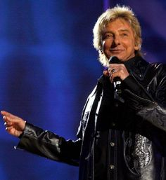 Barry Manilow - you know you know all the words to his songs, like it or not. :)