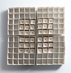Ceramic Arts London - Isobel Egan - Internal Spaces, Size: Hand-built porcelain grids mounted onto a bespoke painted backing piece. Thirty-six hand-built porcelain boxes. Fired to 1250 degrees. Ceramic Wall Art, Ceramic Clay, Ceramic Pottery, Pottery Art, Modern Ceramics, Contemporary Ceramics, Royal College Of Art, Paperclay, Contemporary Artwork