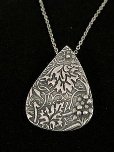 fine Silvert tear shaped grape vine pendant