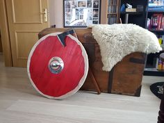 Red viking shield with axe and chest