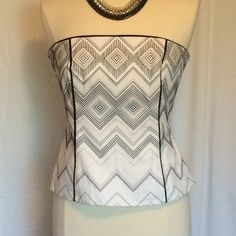 New WHBM embroidered bustier. So cute! Bought this cute bustier and never had a chance to wear it. Size 6. Lined in cotton. Gorgeous embroidered design. Constructed with boning and back zipper. Comes with optional adjustable straps. White House Black Market Tops