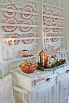 Strawberry Shortcake blog:  Wonderful white Christmas decor with red transfer-ware dishes and delicate delicious gingerbread...yum.