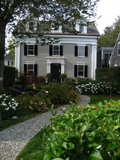 New England Home with traditional garden