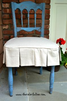 #Miss Mustardseed's Flow Blue #Milk Paint that I used on this old chair.  Made a pretty little #linen cover to hide the ugly pattern underneath!
