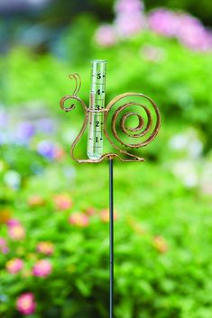 Snail Staked Metal Garden Art Rain Gauge - Even the slowest journey is worth taking. Remind yourself to relax and unwind while tracking rainfall. Our whimsical snail is sure to bring smiles wherever he goes! Like other Happy Gardens rain gauges, this one has been individually handcrafted, and will bring lasting beauty to your lawn or garden. #raingauge #gardenart #metalgardenart #gardendecor #snails #snail #gardendecoration #metalart #garden #gardening #gardenideas #gardenornament